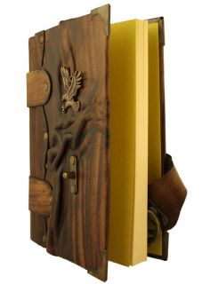 Sculpture on A Large Brown Leather Bound Journal Notebook Diary