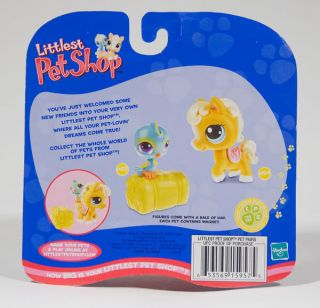 This is a Brand New Retired Littlest Pet Shop Pony #124 and Blue Bird