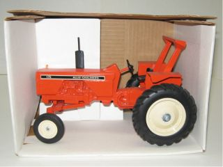 is a 1/16 ALLIS CHALMERS 175 ROPS wide front tractor with diecast rims