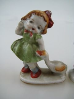 Porcelain Girl Duck Boy and Rabbits Occupied Japan Figural Figurine
