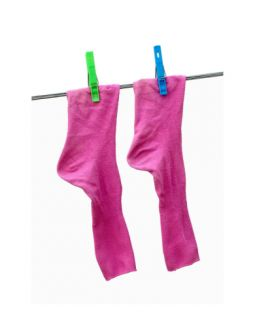 Pink socks with green and blue clothes pins on a washing line. Photographic Print by Frank Tschakert