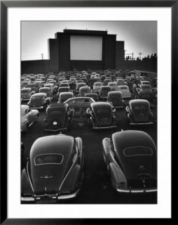 Cars Filling Lot at New Rancho Drive in Theater at Dusk Before the Start of the Feature Movie Pre made Frame