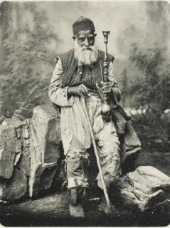 A Venerable Syrian Beggar (Or Very Poor Man) Seated Holding His Hookah Pipe Photographic Print
