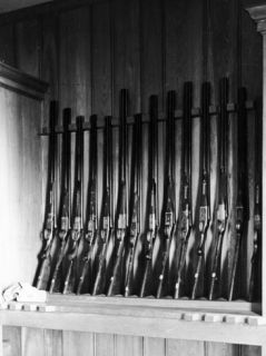 Private Collection of Fourteen Double Barreled Shotguns Premium Photographic Print
