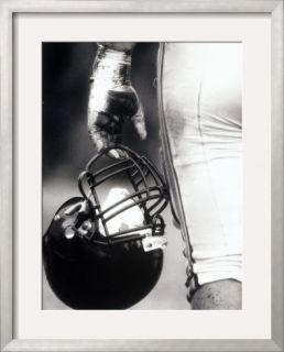 Low Angle View of An American Football Player Holding a Helmet Framed Photographic Print