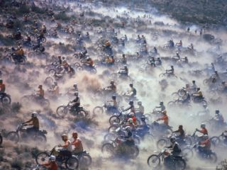 Motorcyclists Racing 75 Miles Cross Country Through Mojave Desert Photographic Print by Bill Eppridge
