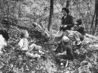 Biologist/Author Rachel Carson Holding Camera with Children and Dog in Woods Near Her Home Premium Photographic Print by Alfred Eisenstaedt