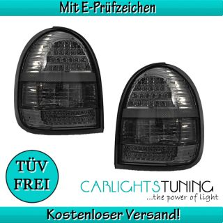 Opel Corsa B Klarglas LED Rueckleuchten Set schwarz smoke black 93 00