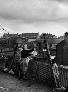 Woman Hanging Wash in a Dublin Slum Premium Photographic Print by Tony Linck