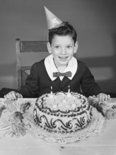 Boy (2 3) in Party Hat with Birthday Cake Photographic Print by George Marks