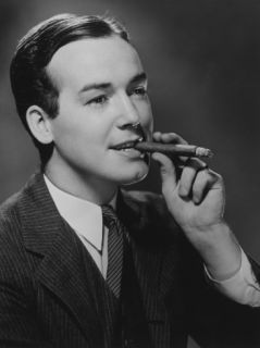 Man Smoking Cigar in Studio Photographic Print by George Marks
