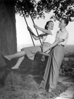 Man Pushing Woman on Swing Hanging From Photographic Print by George Marks