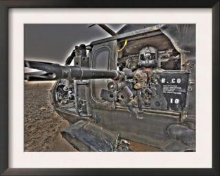A UH 60 Black Hawk Door Gunner Manning a M240G Medium Machine Gun Prints