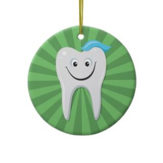 Happy cartoon tooth on a green background ornament