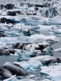 Muli Colored Ice in he Waer a he Vanajokull Icefield Phoographic Prin by Maias Klum