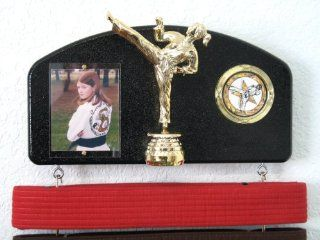 Martial arts belt display with a KICK  Midn. trophy