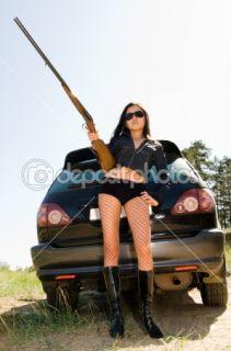 Girl with gun  Stock Photo © Alexander Podshivalov #1398807