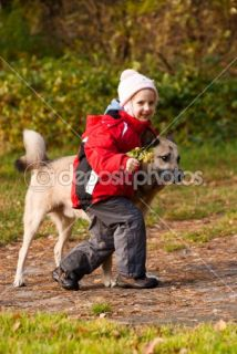 Little girl playing with her dog  Stock Photo © Alexander Semenov