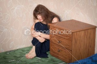 Sad girl in a dress sits in a corner  Stock Photo © pz.axe #2310863